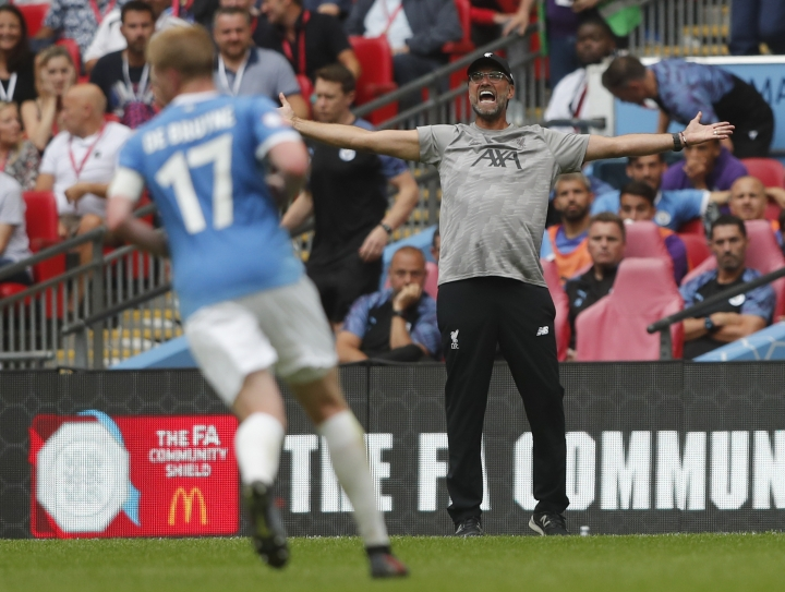 Liverpool's manager Jurgen Klopp reacts to his players during the Community Shield soccer match between Manchester City and Liverpool at Wembley Stadium in London, Sunday, Aug. 4, 2019. (AP Photo/Frank Augstein)