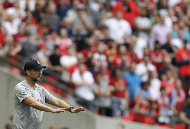 Liverpool's manager Jurgen Klopp gestures after Joel Matip scored his team's equalizer during the English Community Shield soccer match between Liverpool and Manchester City at Wembley stadium in London, Sunday, Aug. 4, 2019. (AP Photo/Kirsty Wigglesworth)