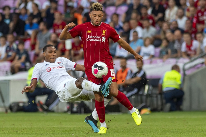 Liverpool's Alex Oxlade-Chamberlain, right, fights for the ball with Lyon's Guedes Marcelo during a friendly soccer match between Liverpool FC and French Olympique Lyonnais at the Stade de Geneve stadium, in Geneva, Switzerland, Wednesday, July 31, 2019. (Martial Trezzini/Keystone via AP)