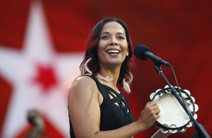 "FILE - In this Tuesday, July 3, 2018, file photo, Rhiannon Giddens performs during rehearsal for the Boston Pops Fireworks Spectacular in Boston. Grammy-winning folk singer and musician Giddens and a pioneering composer named Francis ""Frank"" Johnson will be the first recipients of the inaugural Legacy of Americana Award, on Sept. 11, 2019, in Nashville, Tenn. (AP Photo/Michael Dwyer, File)"