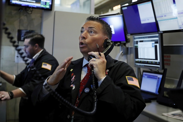 FILE - In this Aug. 6, 2019, file photo trader Jonathan Mueller works on the floor of the New York Stock Exchange. The U.S. stock market opens at 9:30 a.m. EDT on Wednesday, Aug. 7. (AP Photo/Richard Drew, File)