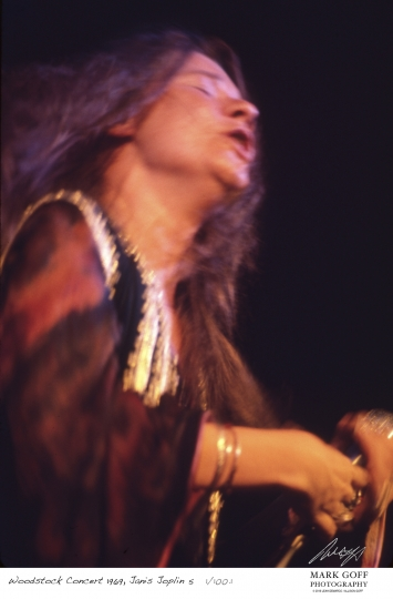 This August, 1969 photo shows Janis Joplin as she performs during Woodstock in Bethel, N.Y. The photo is only one of hundreds made by photographer Mark Goff who, at the time, worked for an underground newspaper in Milwaukee, Wis. Some were published, but the negatives were filed away at his Milwaukee home and barely mentioned as Goff raised two daughters, changed careers and, last November, died of cancer. Dozens of Goff's Woodstock shots are being displayed 50 years later. (Mark Goff Photography, Leah Demarco/Allison Goff via AP)