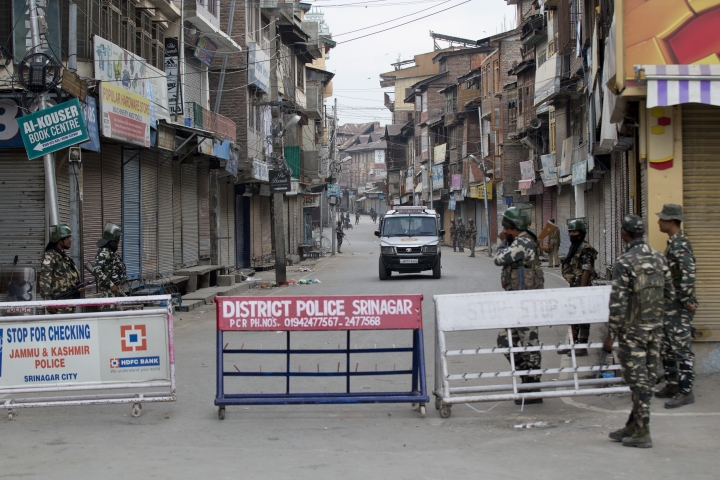In this Tuesday, Aug. 6, 2019 photo, Indian paramilitary soldiers stand guard during curfew in Srinagar, Indian controlled Kashmir. The lives of millions in India's only Muslim-majority region have been upended since the latest — and most serious — crackdown followed a decision by New Delhi to revoke the special status of Jammu and Kashmir and downgrade the Himalayan region from statehood to a territory. Kashmir is claimed in full by both India and Pakistan, and rebels have been fighting Indian rule in the portion it administers for decades. (AP Photo/Dar Yasin)