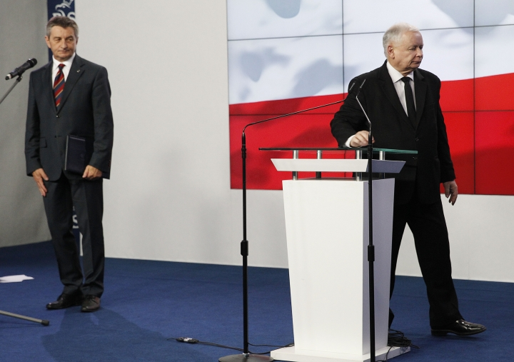 Jaroslaw Kaczynski,right, the head of Poland's ruling party, and parliament speaker Marek Kuchcinski after at a news conference where Kuchcinski announces his resignation in Warsaw, Poland, on Thursday Aug. 8, 2019. Kuchcinski's resignation was prompted by public anger over his and his family's frequent use of government aircraft. Kuchcinski and Kaczynski insisted that the speaker had broken no law and did nothing wrong but that they were acting in response to the public anger.(AP Photo/Czarek Sokolowski)