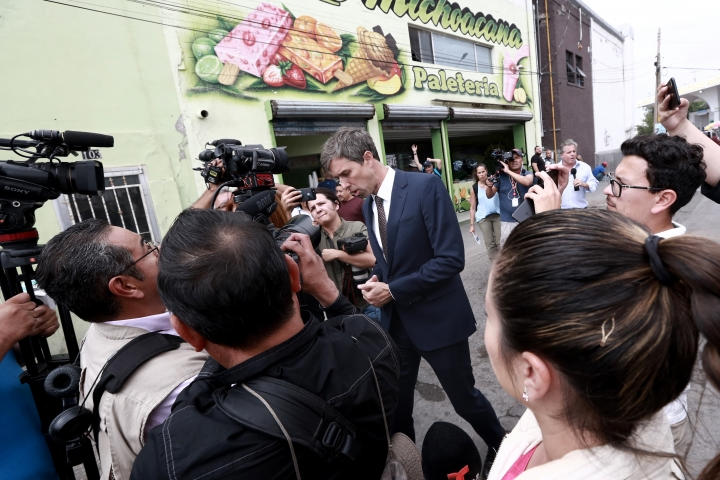 Democratic presidential candidate Beto O'Rourke talks with reporters after crossing into Ciudad Juarez, Mexico, Thursday, Aug. 8, 2019. O'Rourke has crossed the border into Mexico for the funeral of one of the 22 people killed in a mass shooting at a Walmart in El Paso, Texas. (AP Photo/Christian Chavez)