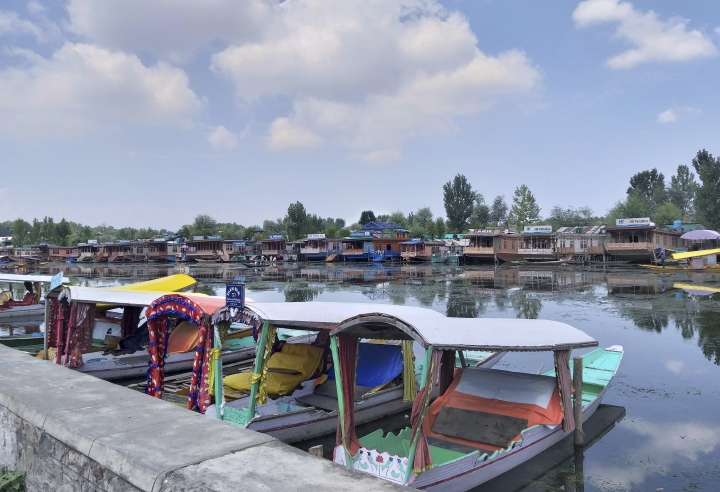 Shikaras, or traditional gondolas, stand parked on the Dal Lake in Srinagar, Indian controlled Kashmir, Thursday, Aug. 8, 2019. The lives of millions in India's only Muslim-majority region have been upended since the latest, and most serious, crackdown followed a decision by New Delhi to revoke the special status of Jammu and Kashmir and downgrade the Himalayan region from statehood to a territory. Kashmir is claimed in full by both India and Pakistan, and rebels have been fighting Indian rule in the portion it administers for decades. (AP Photo/Sheikh Saaliq)