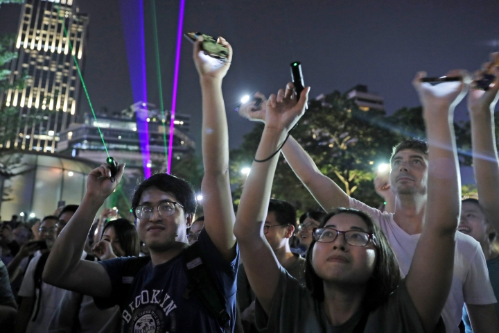"Protesters use laser pointers during a rally to demonstrate against the arrests of people caught in possession of laser pointers that police classified as offensive weapons because of their ability to harm the eyes in Hong Kong on Wednesday, Aug. 7, 2019. Hong Kong is facing its ""most severe situation"" since its handover from British rule in 1997 following weeks of demonstrations and the central government is considering what measures to take next, the head of Beijing's Cabinet office responsible for the territory said Wednesday. (AP Photo/Kin Cheung)"