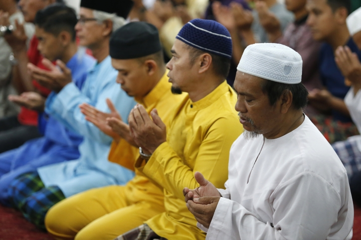 Muslims perform a special prayer for a missing British girl at a mosque in Seremban, Negeri Sembilan, Malaysia, Friday, Aug. 9, 2019. Malaysian rescuers played a recording of the voice of the mother of a 15-year-old London girl who mysteriously disappeared from a forest resort, as the search entered a sixth day Friday and her family made an emotional appeal for support. (AP Photo/Lai Seng Sin)