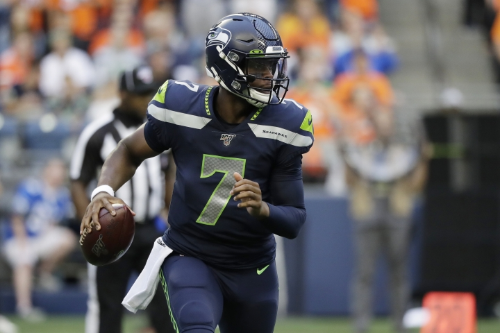 Seattle Seahawks quarterback Geno Smith looks to pass during the first half of the team's NFL football preseason game against the Denver Broncos, Thursday, Aug. 8, 2019, in Seattle. (AP Photo/Elaine Thompson)