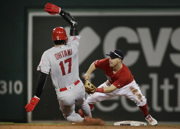 Los Angeles Angels' Shohei Ohtani (17) is out trying to steal second as Boston Red Sox second baseman Brock Holt takes the throw during the third inning of a baseball game at Fenway Park, Friday, Aug. 9, 2019, in Boston. (AP Photo/Elise Amendola)