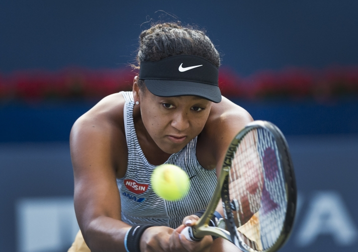 Naomi Osaka, of Japan, returns the ball to Serena Williams, of the United States, during the Rogers Cup women's tennis tournament Friday, Aug. 9, 2019, in Toronto. (Nathan Denette/The Canadian Press via AP)