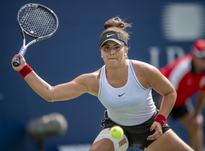 Bianca Andreescu, of Canada, lunges for a forehand on her way to defeating Karolina Pliskova, of the Czech Republic, during quarterfinal play at the Rogers Cup tennis tournament Friday, Aug. 9, 2019, in Toronto. (Fran Gunn/The Canadian Press via AP)