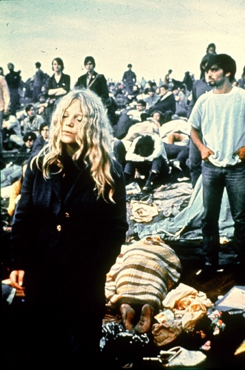 "In this August 1969 file photo, rock music fans listen to performers at the Woodstock Festival of Arts and Music in Bethel, N.Y. To some Americans, the pivotal festival of ""peace and music"" 50 years ago was an inspiring moment of countercultural community and youthful freethinking. To others, it was an outrageous display of indulgence, moral decay and insouciance in a time of war. To still others, it was just a world apart from theirs. (AP File Photo)"