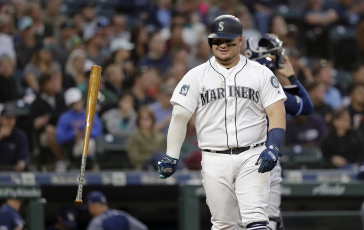 Seattle Mariners' Daniel Vogelbach tosses his bat aside after striking out against the Tampa Bay Rays during the third inning of a baseball game Friday, Aug. 9, 2019, in Seattle. (AP Photo/Elaine Thompson)