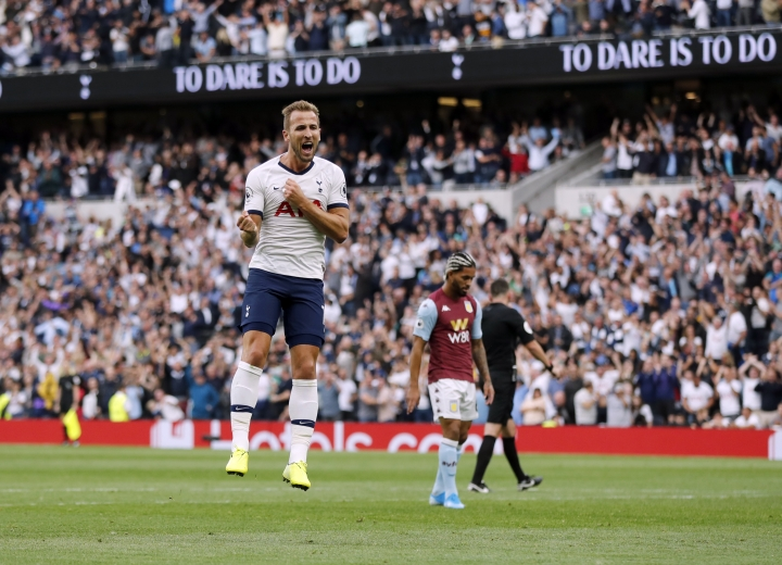 Tottenham's Harry Kane celebrates after scoring his side's third goal during the English Premier League soccer match between Tottenham Hotspur and Aston Villa at the Tottenham Hotspur stadium in London, Saturday, Aug. 10, 2019. (AP Photo/Frank Augstein)
