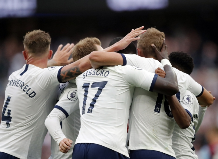 Tottenham's Harry Kane celebrates with teammates after scoring his side's third goal during the English Premier League soccer match between Tottenham Hotspur and Aston Villa at the Tottenham Hotspur stadium in London, Saturday, Aug. 10, 2019. (AP Photo/Frank Augstein)