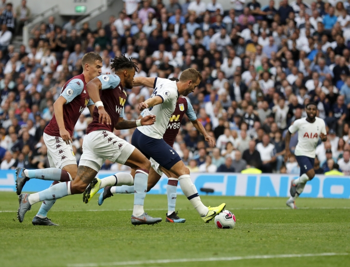 Tottenham's Harry Kane, center, scores his side's second goal during the English Premier League soccer match between Tottenham Hotspur and Aston Villa at the Tottenham Hotspur stadium in London, Saturday, Aug. 10, 2019. (AP Photo/Frank Augstein)