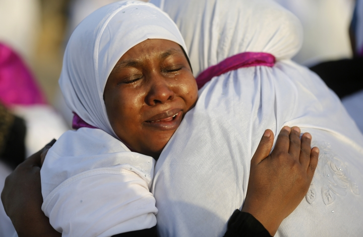 Sudanese pilgrims embrace as they congratulate each other for performing the annual hajj pilgrimage near the Mountain of Mercy, on the Plain of Arafat, near the holy city of Mecca, Saudi Arabia, Saturday, Aug. 10, 2019. More than 2 million pilgrims were gathered to perform initial rites of the hajj, an Islamic pilgrimage that takes the faithful along a path traversed by the Prophet Muhammad some 1,400 years ago. (AP Photo/Amr Nabil)