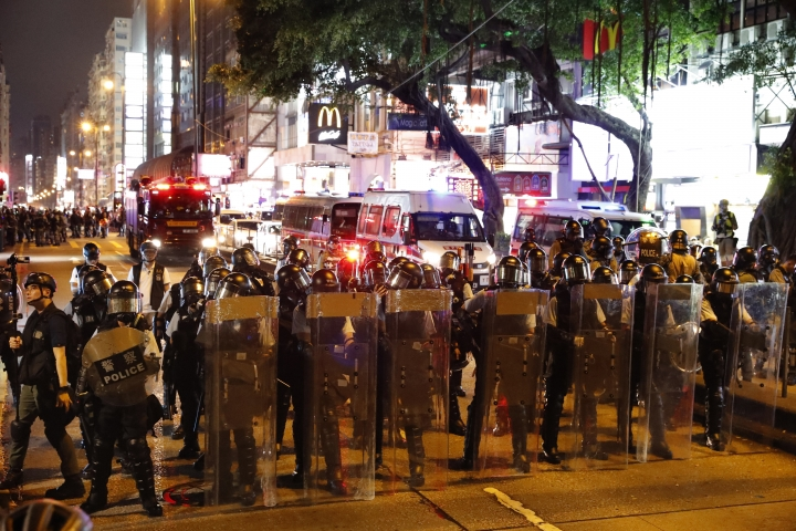 Police form up near the Tsim Sha Tsui police station in Hong Kong on Saturday, Aug. 10, 2019. Hong Kong is in its ninth week of demonstrations that began in response to a proposed extradition law but have expanded to include other grievances and demands for more democratic freedoms. (AP Photo/Vincent Thian)