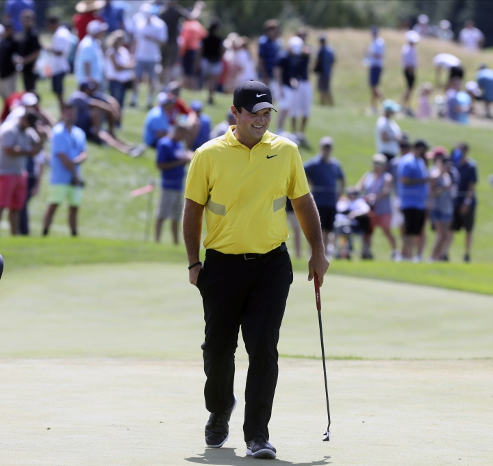 Patrick Reed approaches the fourth green during the Northern Trust golf tournament at Liberty National Golf Course, Saturday, Aug. 10, 2019 in Jersey City, N.J. (Chris Pedota/The Record via AP)
