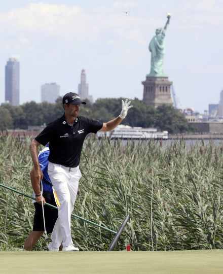 Webb Simpson celebrates a birdie after he hits out of the bunker on the 14 hole during the Northern Trust golf tournament at Liberty National Golf Course, Saturday, Aug. 10, 2019 in Jersey City, N.J. (Chris Pedota/The Record via AP)