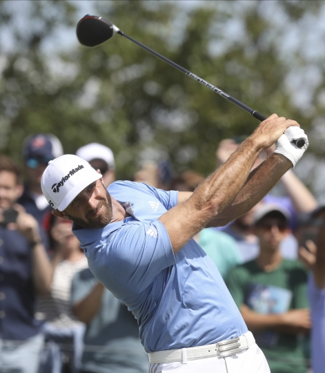 Dustin Johnson tees off on the fifth hole during the Northern Trust golf tournament at Liberty National Golf Course, Saturday, Aug. 10, 2019 in Jersey City, N.J. (Chris Pedota/The Record via AP)