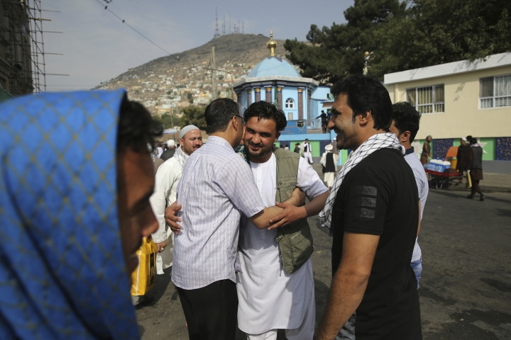 Afghan Muslims greet each other after offering Eid al-Adha prayers in Kabul, Afghanistan, Sunday, Aug. 11, 2019. Muslim people in the country celebrate Eid al-Adha, or the Feast of the Sacrifice by slaughtering sheep, goats and cows whose meat will later be distributed to the poor. (AP Photo/Rafiq Maqbool)