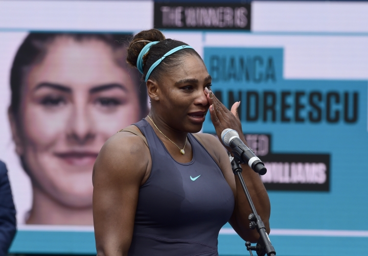 Serena Williams, of the United States, reacts after she had to retire during the final of the Rogers Cup tennis tournament against Canada's Bianca Andreescu in Toronto, Sunday, Aug. 11, 2019. (Frank Gunn/The Canadian Press via AP)