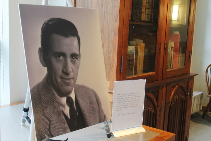 "FILE - In a Tuesday, Jan. 22, 2019 file photo, a previously unseen photo of author J.D. Salinger is displayed at the University of New Hampshire in Durham, N.H. 'The Catcher in the Rye' author is going digital The late J.D. Salinger is giving in to the digital revolution. Longtime Salinger publisher Little, Brown and Company says it's the first time that the entirety of Salinger's published work, including ""The Catcher and the Rye,"" will be available as e-books. The electronic publication is happening Tuesday, August 13, 2019. (AP Photo/Holly Ramer, File)"