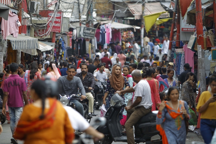 People throng a market on the eve of Eid al Adha, in Jammu, India, Sunday, Aug.11, 2019. Authorities in Indian-administered Kashmir said that they eased restrictions Sunday in most parts of Srinagar, the main city, ahead of an Islamic festival following India's decision to strip the region of its constitutional autonomy. There was no immediate independent confirmation of reports by authorities that people were visiting shopping areas for festival purchases as all communications and the internet remain cut off for a seventh day. (AP Photo/Channi Anand)