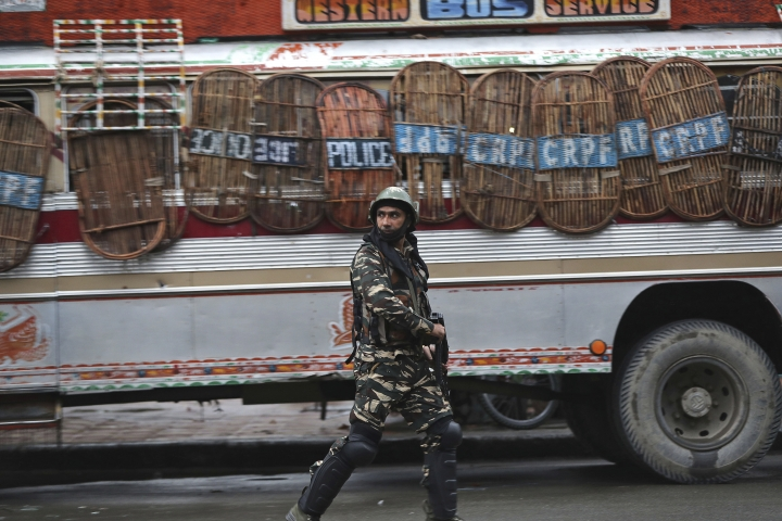 An Indian paramilitary soldier patrols a street in Srinagar, Indian controlled Kashmir, Saturday, Aug. 10, 2019. Authorities enforcing a strict curfew in Indian-administered Kashmir will bring in trucks of essential supplies for an Islamic festival next week, as the divided Himalayan region remained in a lockdown following India's decision to strip it of its constitutional autonomy. The indefinite 24-hour curfew was briefly eased on Friday for weekly Muslim prayers in some parts of Srinagar, the region's main city, but thousands of residents are still forced to stay indoors with shops and most health clinics closed. All communications and the internet remain cut off. (AP Photo/Mukhtar Khan)