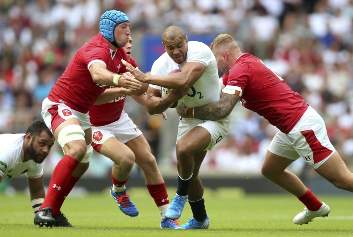 Wales players compete to reach England's Jonathan Joseph, centre, during their International rugby match at Twickenham Stadium in London, Sunday Aug. 11, 2019. (Nigel French/PA via AP)