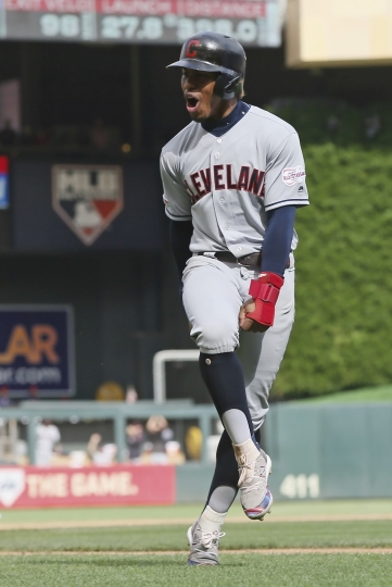 Cleveland Indians Greg Allen celebrates as he rounds the bases on a grand slam by Carlos Santana off Minnesota Twins pitcher Taylor Rogers in the 10th inning of a baseball game Sunday, Aug. 11, 2019, in Minneapolis. The Indians won 7-3. Allen homered in the first inning. (AP Photo/Jim Mone)