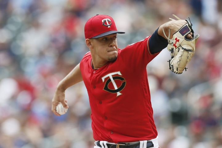 Minnesota Twins pitcher Jose Berrios throws against the Cleveland Indians in the first inning of a baseball game Sunday, Aug. 11, 2019, in Minneapolis. (AP Photo/Jim Mone)
