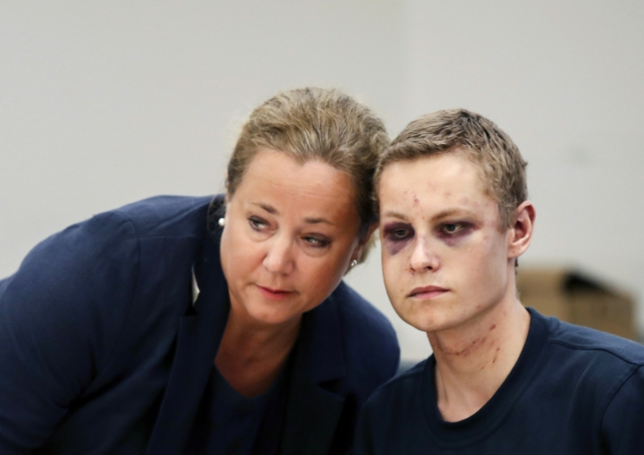 "Suspect gunman Philip Manshaus, right and his lawyer Unni Fries attend a court hearing, in Oslo, Norway, Monday, Aug. 12, 2019. A suspected gunman accused of an attempted terrorist attack on an Oslo mosque and separately killing his teenage stepsister ""will use his right not to explain himself for now"" in a detention hearing, his defense lawyer said Monday. (Cornelius Poppen, NTB scanpix via AP)"