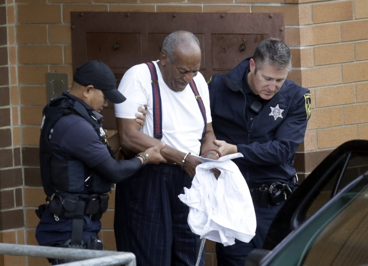 FILE - In this Sept. 25, 2018 file photo Bill Cosby is escorted out of the Montgomery County Correctional Facility, in Eagleville, Pa., following his sentencing to three-to-10-year prison sentence for sexual assault. A Pennsylvania appeals court will hear arguments, Monday, Aug. 12, 2019, as Cosby appeals his sexual assault conviction. The 82-year-old Cosby is serving a three- to 10-year prison term. (AP Photo/Jacqueline Larma, File)