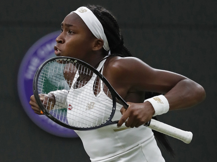 FILE - In this July 3, 2019, file photo, Coco Gauff celebrates after beating Slovakia's Magdalena Rybaikova in a women's singles match at the Wimbledon Tennis Championships in London. Gauff will get a chance to try for an encore: The 15-year-old from Florida received a wild-card entry Tuesday, Aug. 13, 2019, for the U.S. Open's main draw. It will be Gauff's second Grand Slam tournament. She made a magical run to the fourth round at Wimbledon last month after getting a wild card into the qualifying rounds there.(AP Photo/Alastair Grant, File)