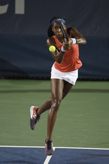 "Cori ""Coco"" Gauff returns the ball as she and Catherine McNally played a doubles match against Anna Kalinskaya, of Russia, and Miyu Kato, of Japan, in the Citi Open tennis tournament, Friday, Aug. 2, 2019, in Washington. (AP Photo/Nick Wass)"