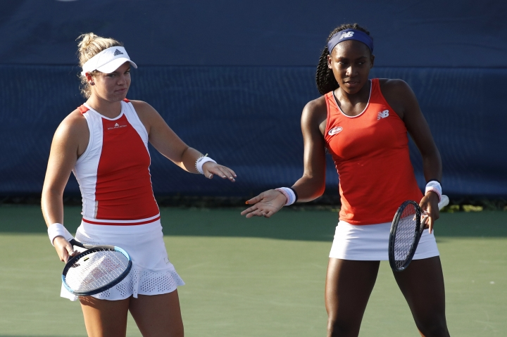 Caty McNally, left, slaps hands with Cori Gauff as they play the women's doubles final against Fanny Stollar, of Hungary, and Maria Sanchez at the Citi Open tennis tournament, Saturday, Aug. 3, 2019, in Washington. (AP Photo/Patrick Semansky)