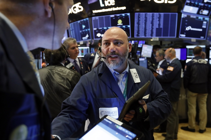 Trader Vincent Napolitano works on the floor of the New York Stock Exchange, Tuesday, Aug. 13, 2019. Stocks shook off an early stumble and edged higher on Wall Street led by gains in technology and health care companies. (AP Photo/Richard Drew)