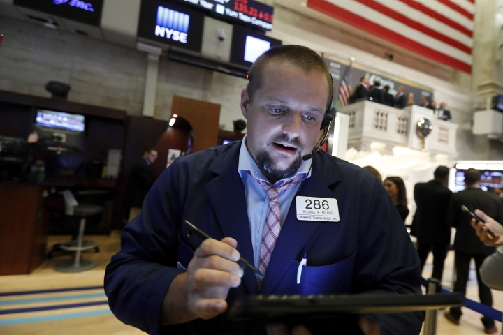 Trader Michael Milano works on the floor of the New York Stock Exchange, Tuesday, Aug. 13, 2019. Stocks shook off an early stumble and edged higher on Wall Street led by gains in technology and health care companies. (AP Photo/Richard Drew)