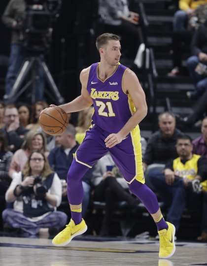 FILE - In this March 19, 2018, file photo, Los Angeles Lakers' Travis Wear plays during the first half of an NBA basketball game against the Indiana Pacers, in Indianapolis. Wear is one of the G League players who helped USA Basketball qualify for the World Cup, and now he and a few others are being brought back to the team for the final week of training camp against NBA players who will actually play in the tournament in China later this month. (AP Photo/Darron Cummings, File)