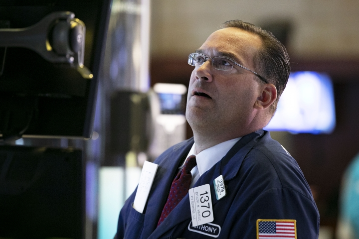 Specialist Anthony Matsic works at his post on the floor of the New York Stock Exchange, Monday, Aug. 12, 2019. Stocks are edging lower in early trading on Wall Street amid investor concerns that the U.S.-China trade war may be worsening. (AP Photo/Richard Drew)