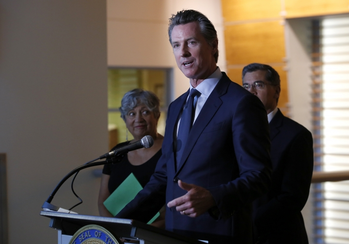 California Gov. Gavin Newsom, accompanied by California Air Resources Board Chairwoman Mary Nichols left, and Attorney General Xavier Becerra, right, discusses the lawsuit the state has joined in with 21 other Democrat-led states against the Trump administration over its decision to ease restrictions on coal-fired power plants. (AP Photo/Rich Pedroncelli)