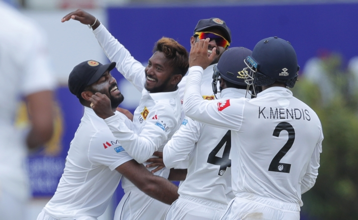 Sri Lanka's bowler Akila Dananjaya, second left, celebrates taking the wicket of New Zealand's Kane Williamson with is team mates during the day one of the first test cricket match between Sri Lanka and New Zealand in Galle, Sri Lanka, Wednesday, Aug. 14, 2019. (AP Photo/Eranga Jayawardena)