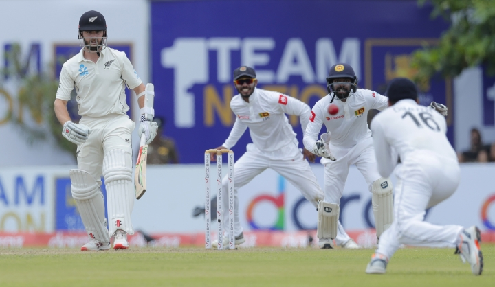 Sri Lanka's captain Dimuth Karunaratne, right, takes a catch to dismiss New Zealand's captain Kane Williamson, left, during the day one of the first test cricket match between Sri Lanka and New Zealand in Galle, Sri Lanka, Wednesday, Aug. 14, 2019. (AP Photo/Eranga Jayawardena)