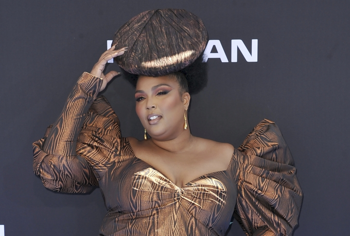 "FILE - In this June 23, 2019 file photo, Lizzo arrives at the BET Awards at the Microsoft Theater in Los Angeles. Lizzo's breakthrough hit ""Truth Hurts"" is a two-year-old song, but it still has a chance at the 2020 Grammys. ""Truth Hurts,"" which was released in 2017, qualifies for the 2020 Grammys because the song was never submitted for contention in the Grammys process and it appears on an album released during the eligibility period for the upcoming show. (Photo by Richard Shotwell/Invision/AP, File)"