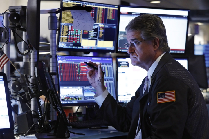 Trader Daniel Krieger works on the floor of the New York Stock Exchange, Wednesday, Aug. 14, 2019. Stocks are falling sharply after the bond market threw up another warning flag on the economy. (AP Photo/Richard Drew)