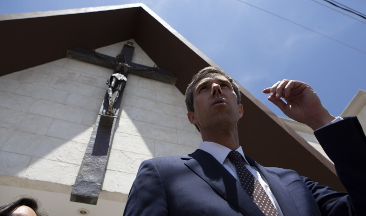 """Democratic presidential candidate Beto O'Rourke, center, departs the Perches funeral home in Ciudad Juarez, Mexico, Thursday, Aug. 8, 2019, after attending a service for Ivan Filiberto Manzano, one of the 22 people killed in a shooting at a Walmart in El Paso. The former El Paso congressman said he came to the border city """"to remind the world that we are a binational community."""" (AP Photo/Christian Chavez)"""