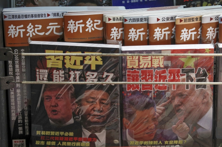 FILE - In this July 4, 2019, photo, Chinese magazines with front covers featuring Chinese President Xi Jinping and U.S. President Donald Trump on trade war are placed for sale at a roadside bookstand in Hong Kong. China on Thursday, Aug. 15, 2019 threatened retaliation if Washington steps up their war over trade and technology by going ahead with planned Sept. 1 tariff hikes on additional Chinese imports. (AP Photo/Andy Wong, File)